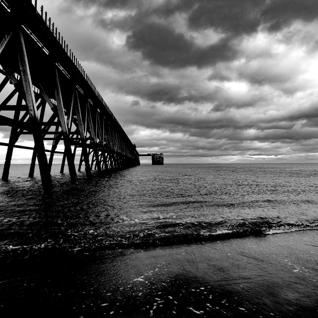 """Pier stretches out to sea"" stock image"