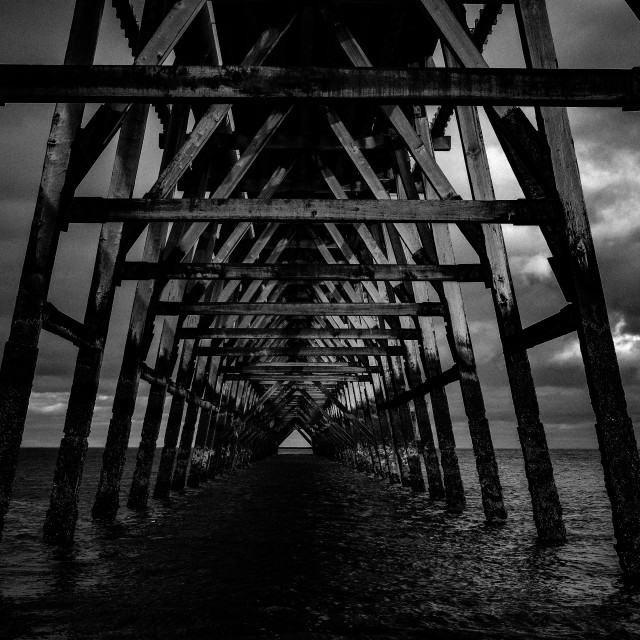 """The disappearing pier."" stock image"