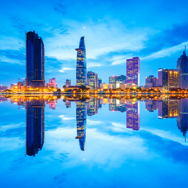 """Reflection of night view of downtown of Saigon"" stock image"