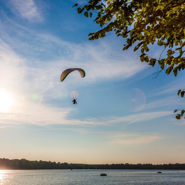 """Paraglide over the lake, Ełk, Mazury, Poland"" stock image"