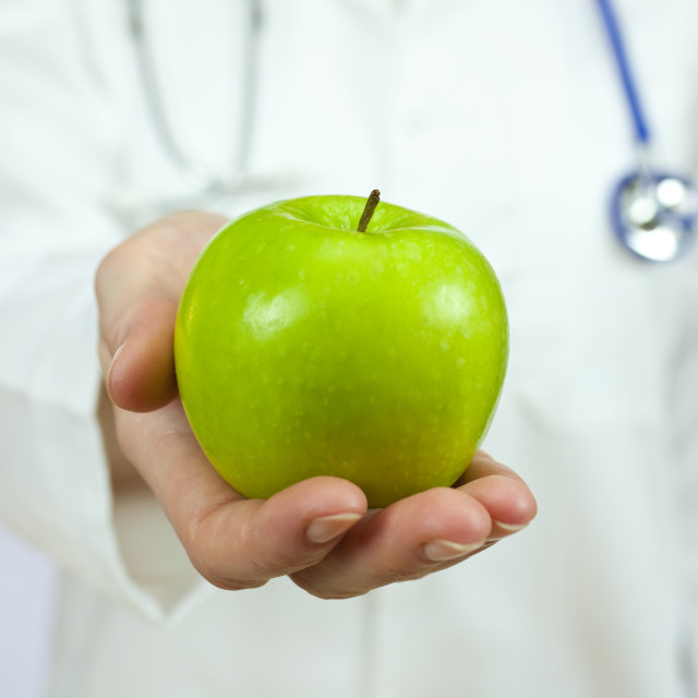 """Doctor Holding Green Apple"" stock image"