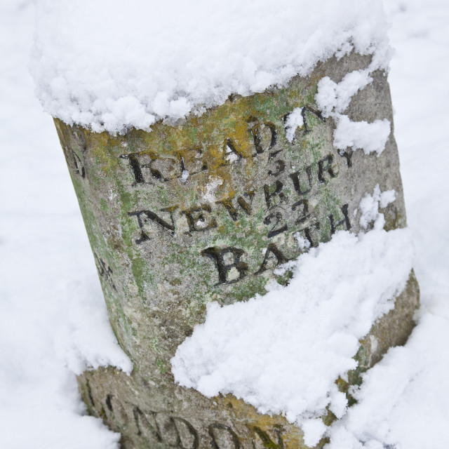 """Vintage British Road Sign Covered In Winter Snow"" stock image"