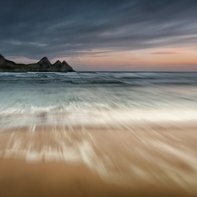 """""""Sunset at Three Cliffs Bay Gower"""" stock image"""