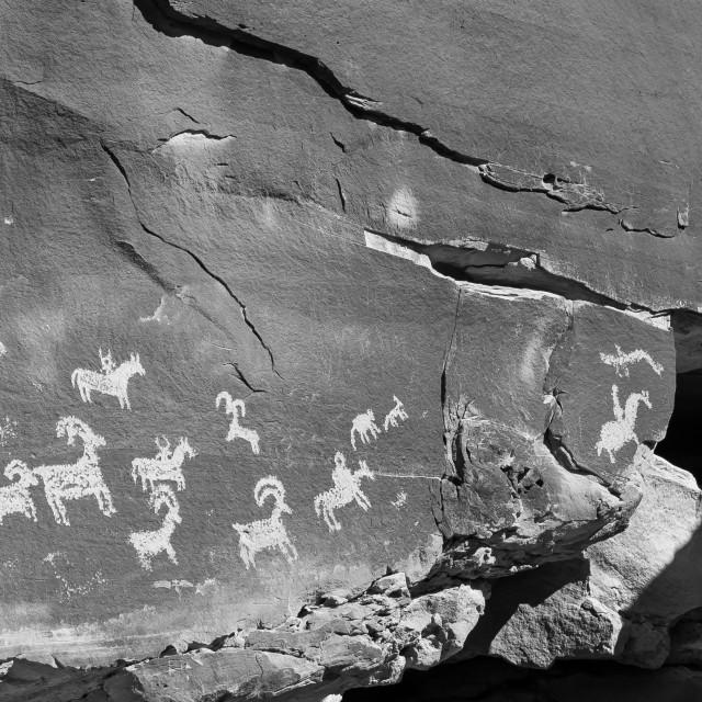 """Petroglyph Hunt"" stock image"