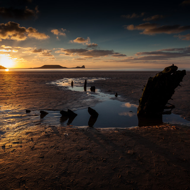 """Rossili Bay, Worm's head and the wreck of Helvetia"" stock image"