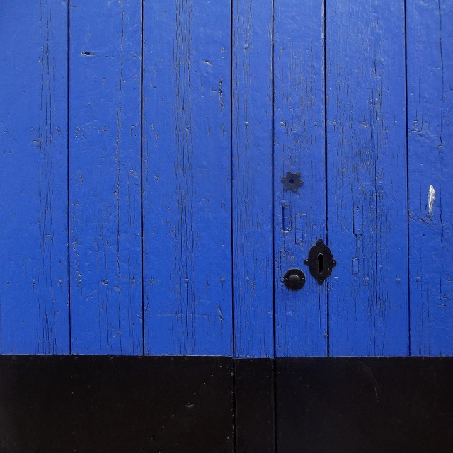 """Royal Blue and Black Old Door"" stock image"