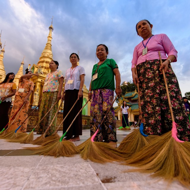 """Devotees sweeping pagoda"" stock image"