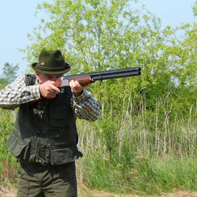 """hunter aiming with shotgun"" stock image"