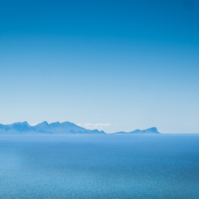 """Distant mountains rise from the horizon. Coastline of False Bay, Cape Town, South Africa"" stock image"