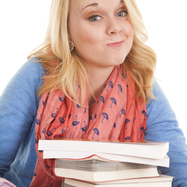 """girl with books smirk"" stock image"