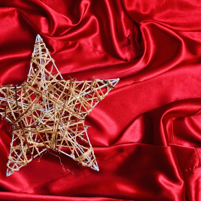 """Christmas tree star on red satin"" stock image"