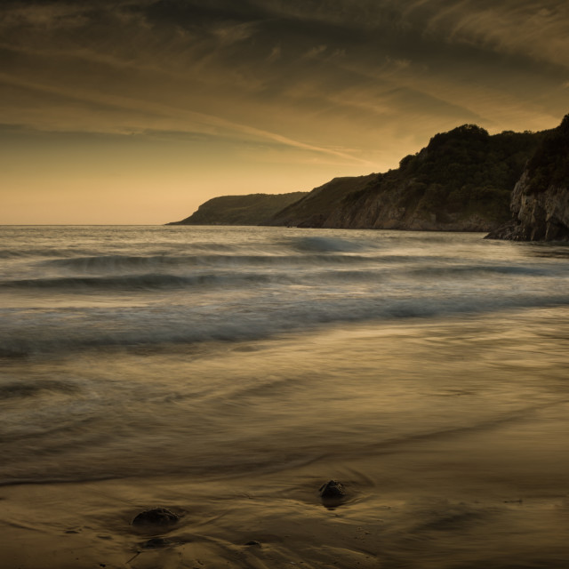 """Sunset at Caswell Bay"" stock image"