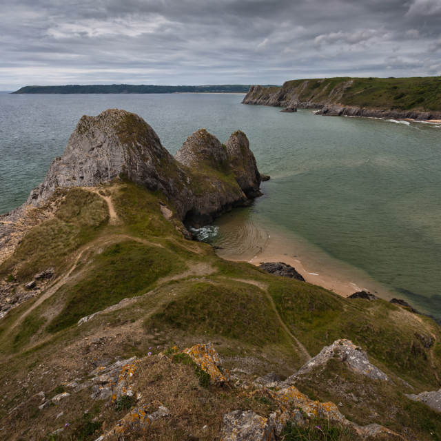"""""""Three Cliffs Bay and the Great Tor"""" stock image"""