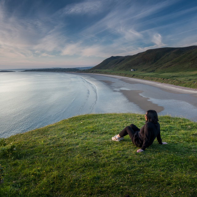 """Relaxing at Rhossili"" stock image"