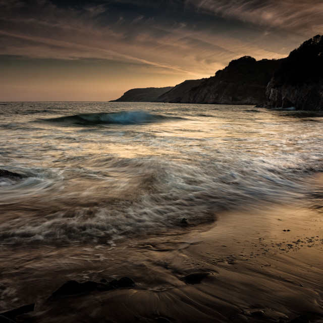 """Dusk at Caswell Bay"" stock image"