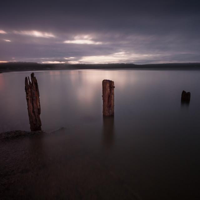 """Swansea Bay groynes at night"" stock image"
