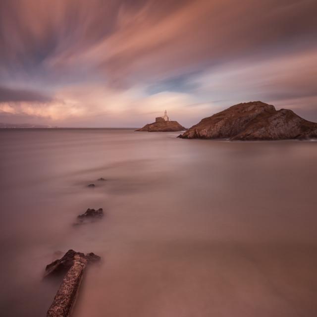 """""""Sunset on Mumbles lighthouse"""" stock image"""