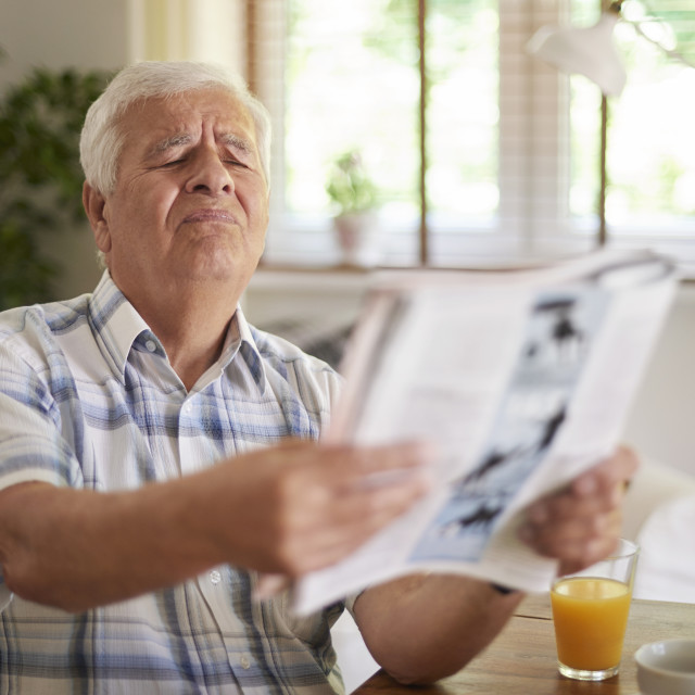 """Problems with eyesight of senior man"" stock image"