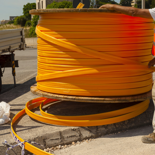 """Industrial cable drums of fiber optic cables from underground in a micro trench"" stock image"