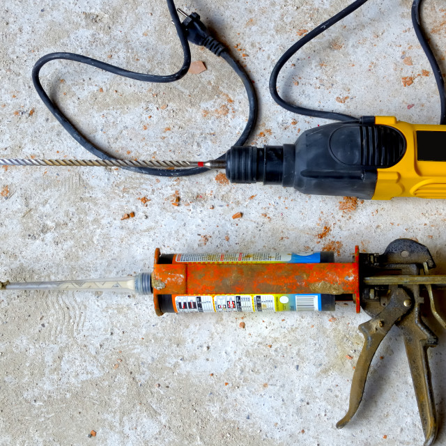 """""""Construction Site: power drill with pistol cartridge resin."""" stock image"""