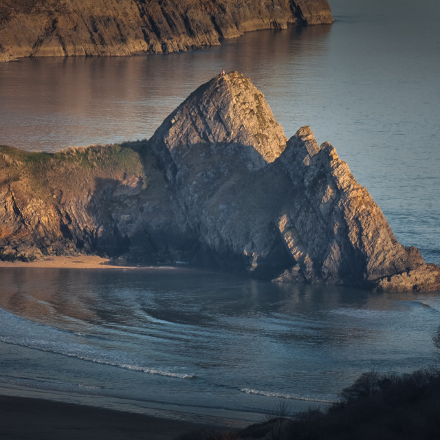 """Evening at Three Cliffs Bay Gower"" stock image"