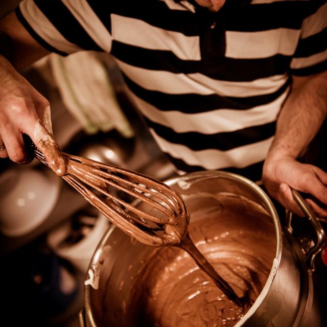 """""""Pastry in his workshop preparing Chocolate Yule logs"""" stock image"""