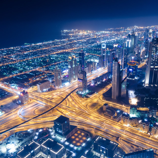 """downtown dubai futuristic city neon lights and sheik zayed road shot from the worlds tallest tower burj khalifa"" stock image"