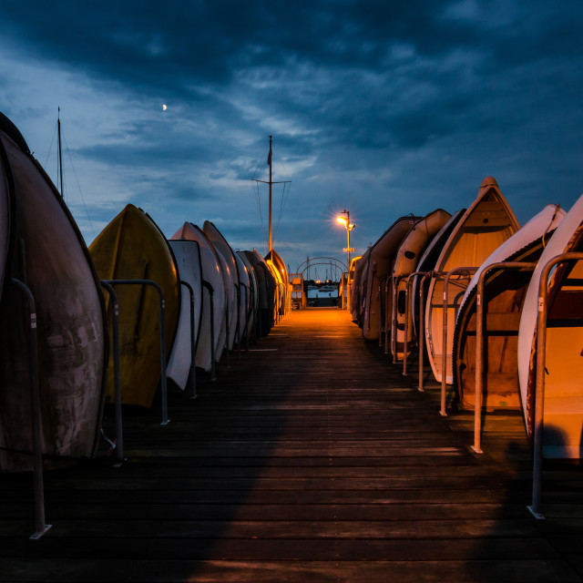 """Dinghies at dusk"" stock image"