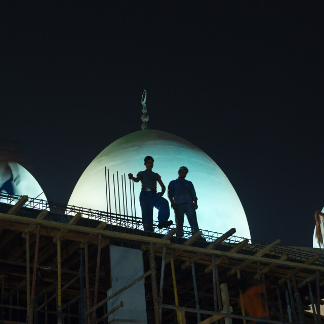 """""""construction workers working in the middle of the night in deira, dubai untied arab emirates"""" stock image"""