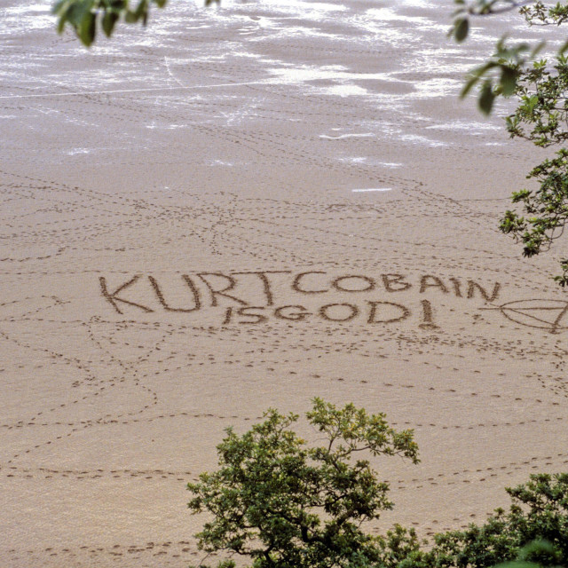 """""Kurt Cobain is God"" Written in the Sand"" stock image"