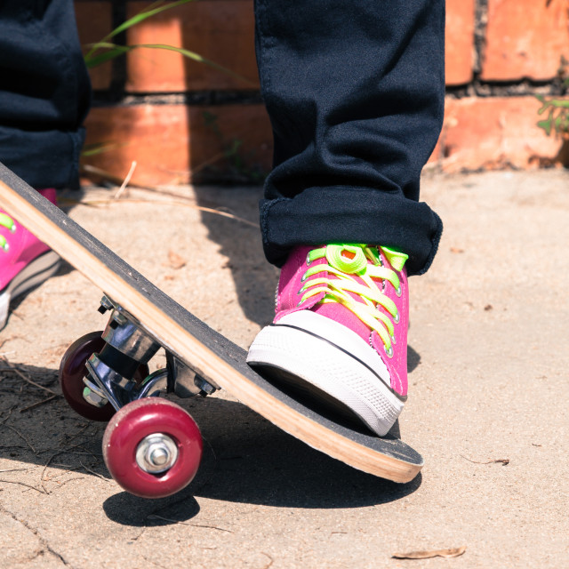 """Girl with a skateboard"" stock image"