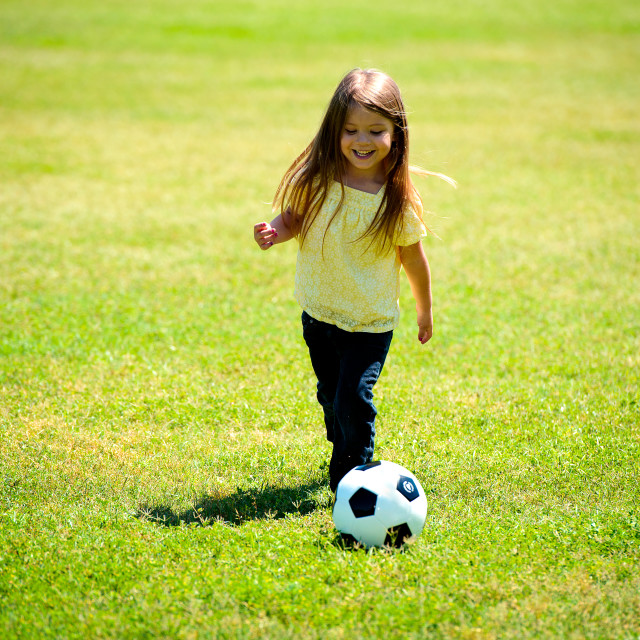 """Young Girl With Soccer Ball"" stock image"