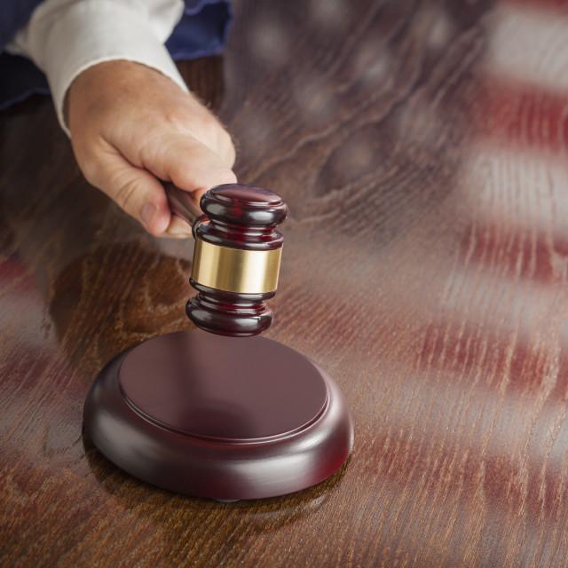 """Judge Slams His Gavel and American Flag Table Reflection."" stock image"