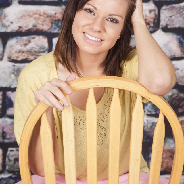 """woman pink pants rock wall sit hand hair"" stock image"