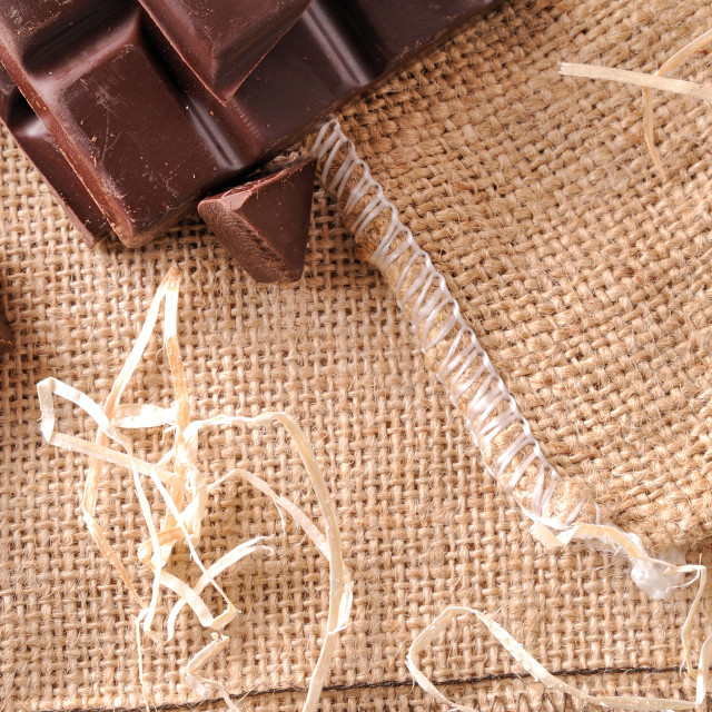 """""""Heap of artisan portions chocolate on burlap top view"""" stock image"""