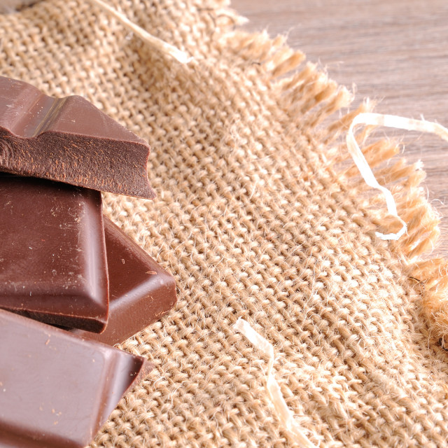 """""""Heap of artisan portions chocolate on burlap elevated top view"""" stock image"""