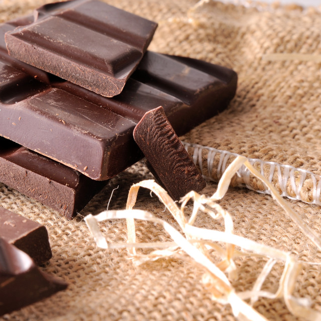 """""""Heap of artisan portions chocolate on burlap front view"""" stock image"""