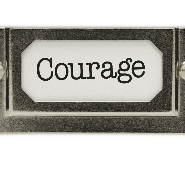 """Courage File Drawer Label Isolated on a White Background."" stock image"