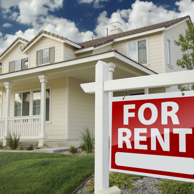 """Left Facing Red For Rent Real Estate Sign in Front of Beautiful House."" stock image"