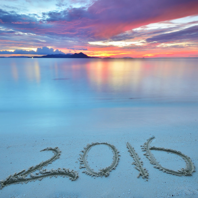 """""""Numbers 2016 written on sandy beach during sunset."""" stock image"""