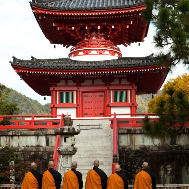 """Chanting Monks at Daikakuji Temple"" stock image"
