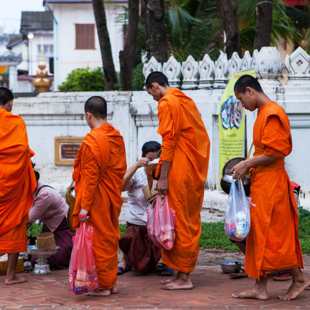 """Monk on his Daily Alms Round, Bangkok"" stock image"