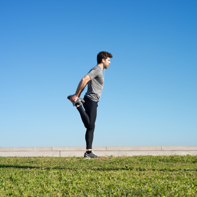 """man stretches the leg before running space for text"" stock image"