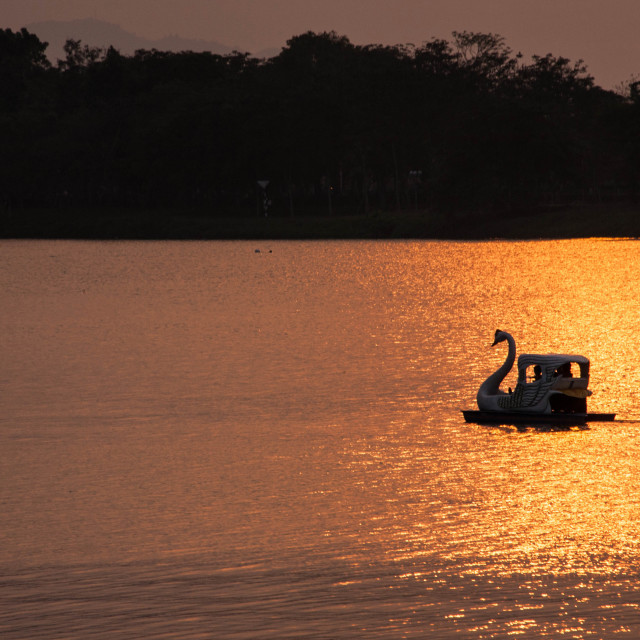 """Perfume River Sunset Swan Boat"" stock image"
