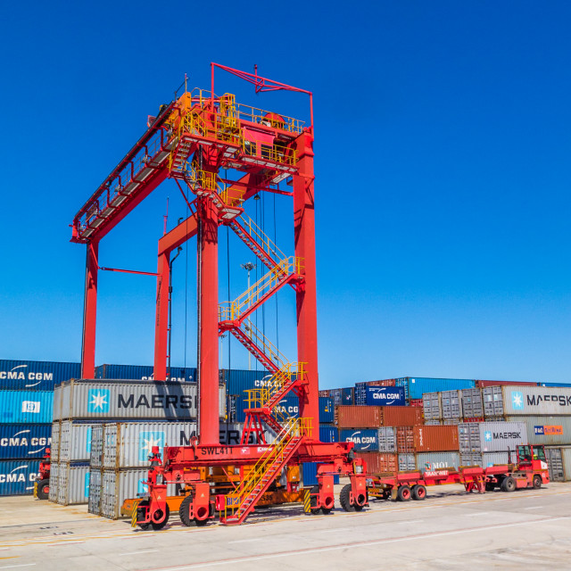 """Container lift. Loads and unpoads containers onto and off flatbed trucks for delivery"" stock image"