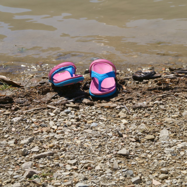 """Slippers near lake"" stock image"