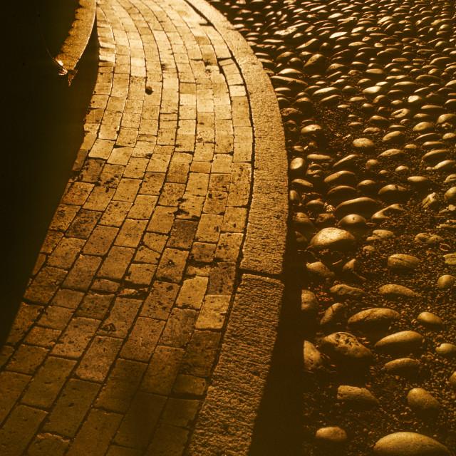 """Brick sidewalk at sunset"" stock image"