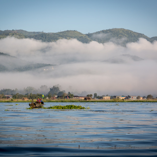 """The morning mist rising on Inlay lake in Myanmar"" stock image"