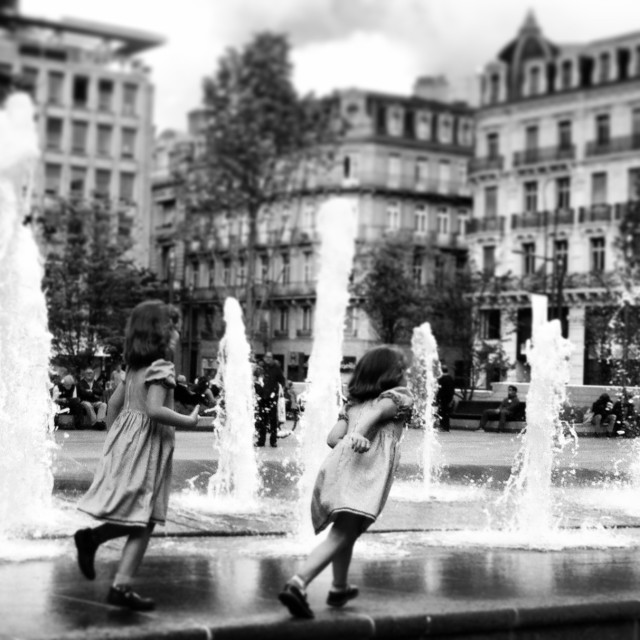 """two girls by the fountain"" stock image"