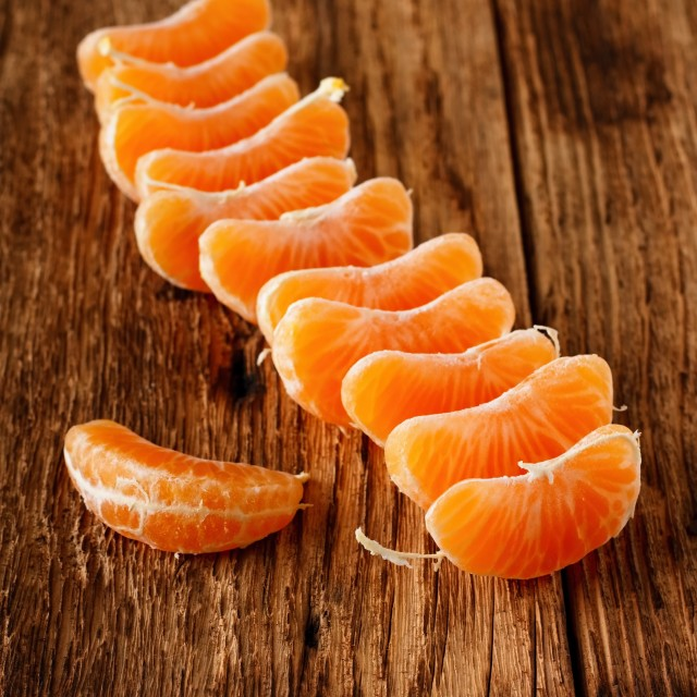 """Mandarin pieces placed in a row"" stock image"